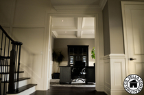 wainscoting, coffered ceiling, crown moulding, painting, hardwood flooring